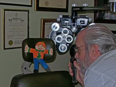 Dr. Young gives Flat Stanley an eye exam
